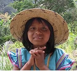 An Indigenouse Ngobe Bugle girl wearing a Panama hat